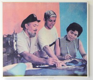 Walter Katin, surfer Claude Codgen, and Sato Hughes consult on trunks in 1967
