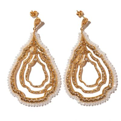 Gold, crystal, and handmade in L.A., earrings by Azaara, $310