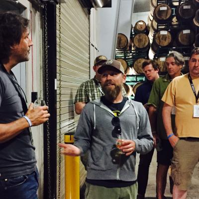 Firestone Walker's Matt Brynildson addresses media in their barrel room.