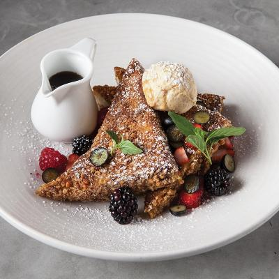 French Toast: granola crusted, maple pecan butter, mixed berries, vermont maple syrup. $13
