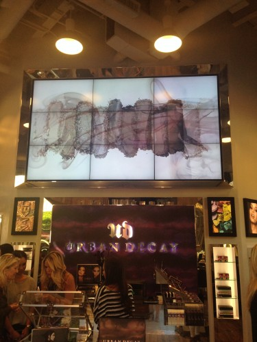 A video screen at the Urban Decay store at Fashion Island displays the shades from the Naked Smoky palette.