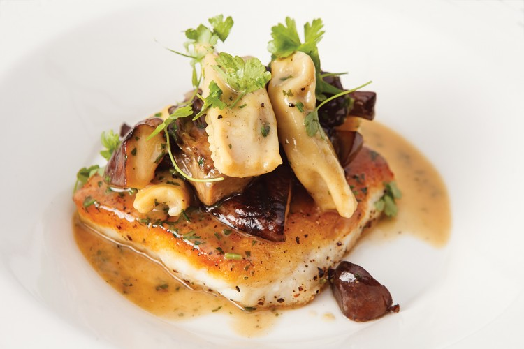 """Local halibut with wild mushrooms and house-made """"burnt bread"""" agnolotti."""