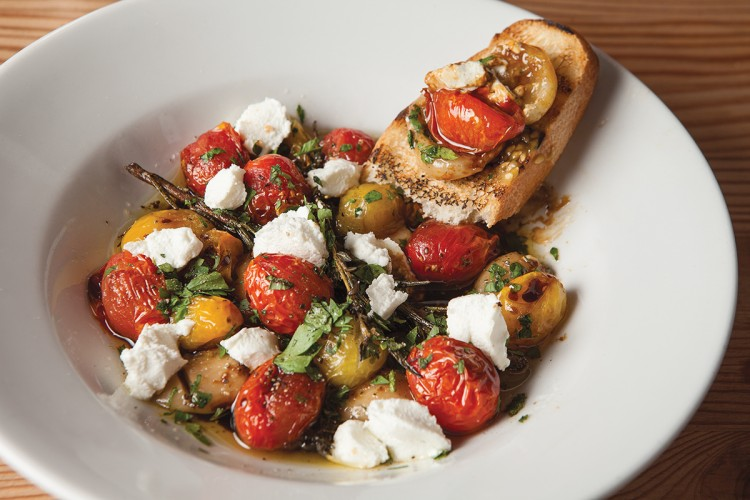 Tuscan Toast with charred fresh tomatoes, roasted garlic confit, and goat cheese