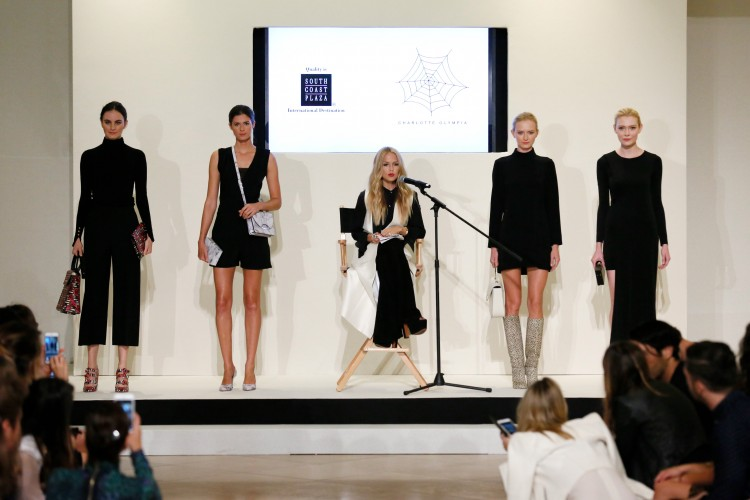 Models wearing shoes and bags by Charlotte Olympia at the Live the Look fashion show at South Coast Plaza on October 8, 2015, in Costa Mesa, California.  (Photo by Ryan Miller/Capture Imaging)