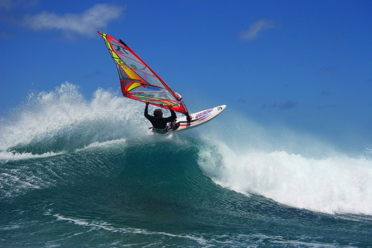 A windsurfer conquering air and sea off Oah'u. Photo credit Hawaii Tourism AuthorityPeter Garzke
