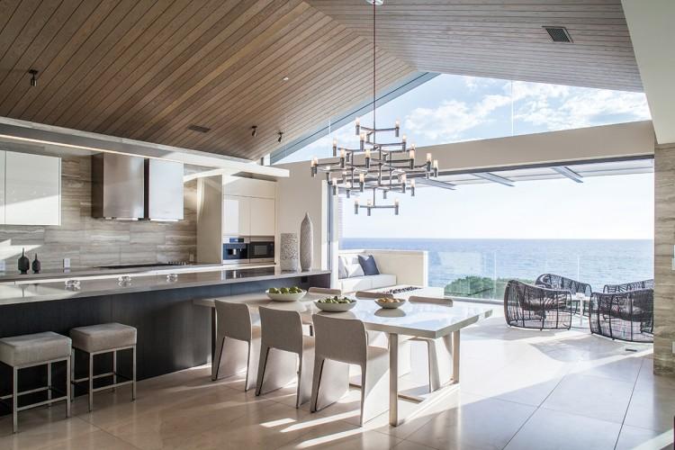 Nemo's sculptural Crown Major chandelier adds panache to the sleek Boffi kitchen.