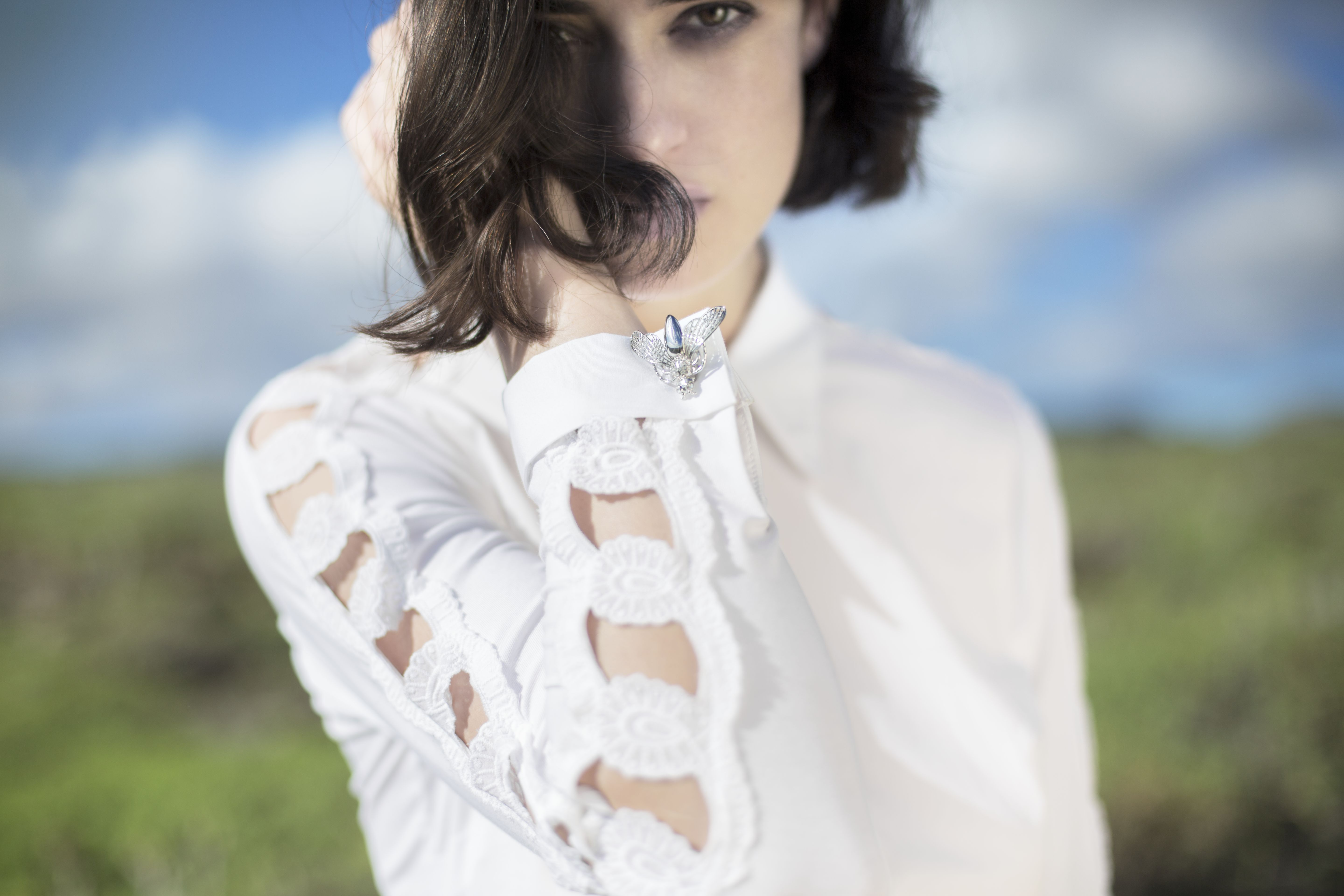 Designer Anne Fontaine reinvents the white shirt every season. For summer she included cutouts