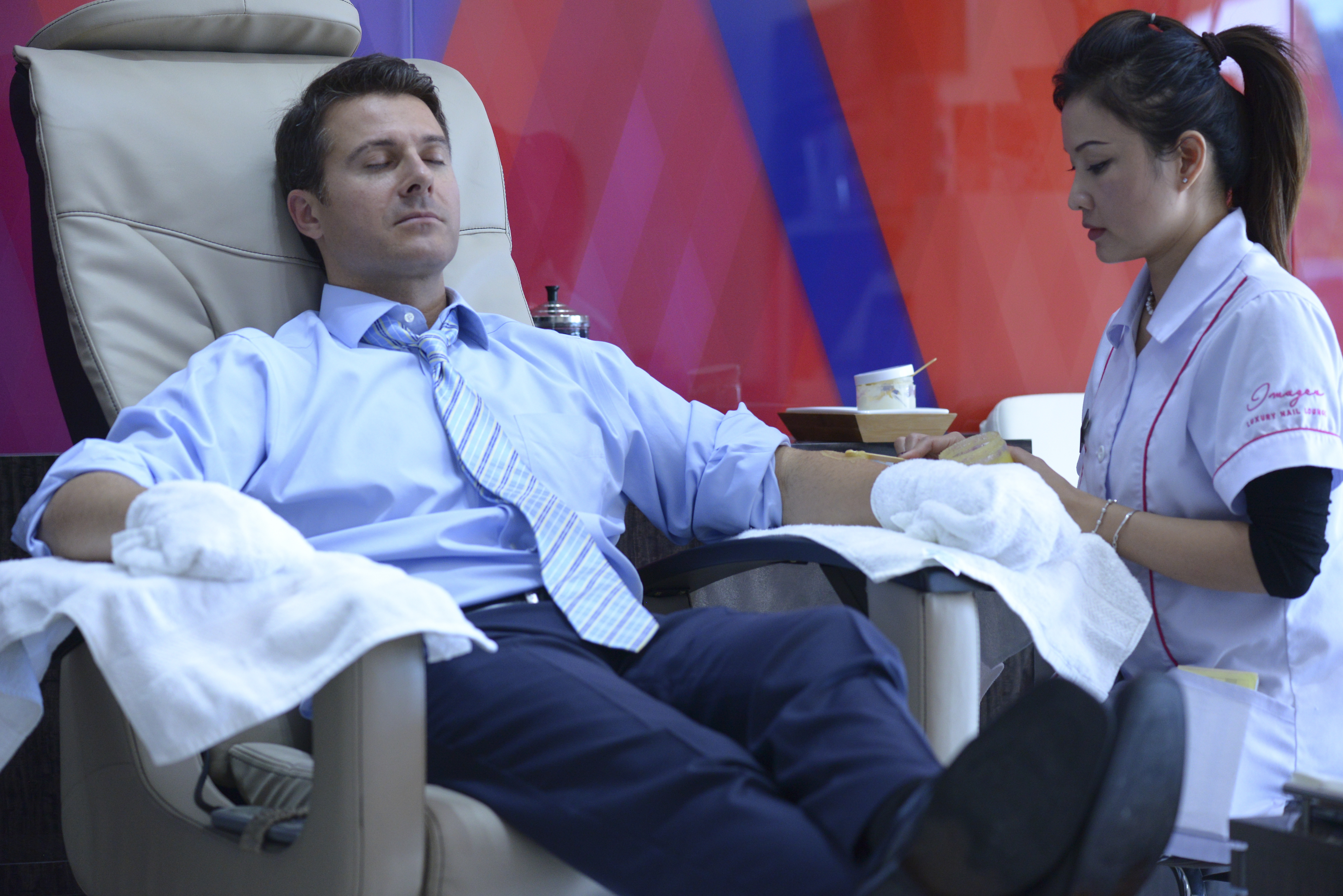 A customer relaxes while getting a Man-I-Cure at Images Nail Salon