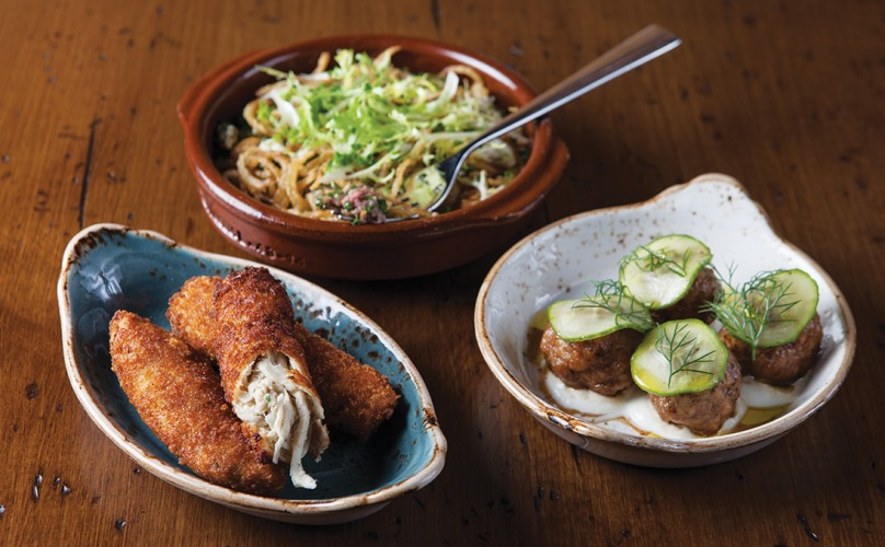 Tapas include the chicken croquettes, the beef tartar with shallots and frisee, and roasted lamb meatballs.