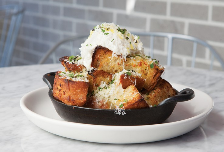 Baked truffle bread topped with ricotta