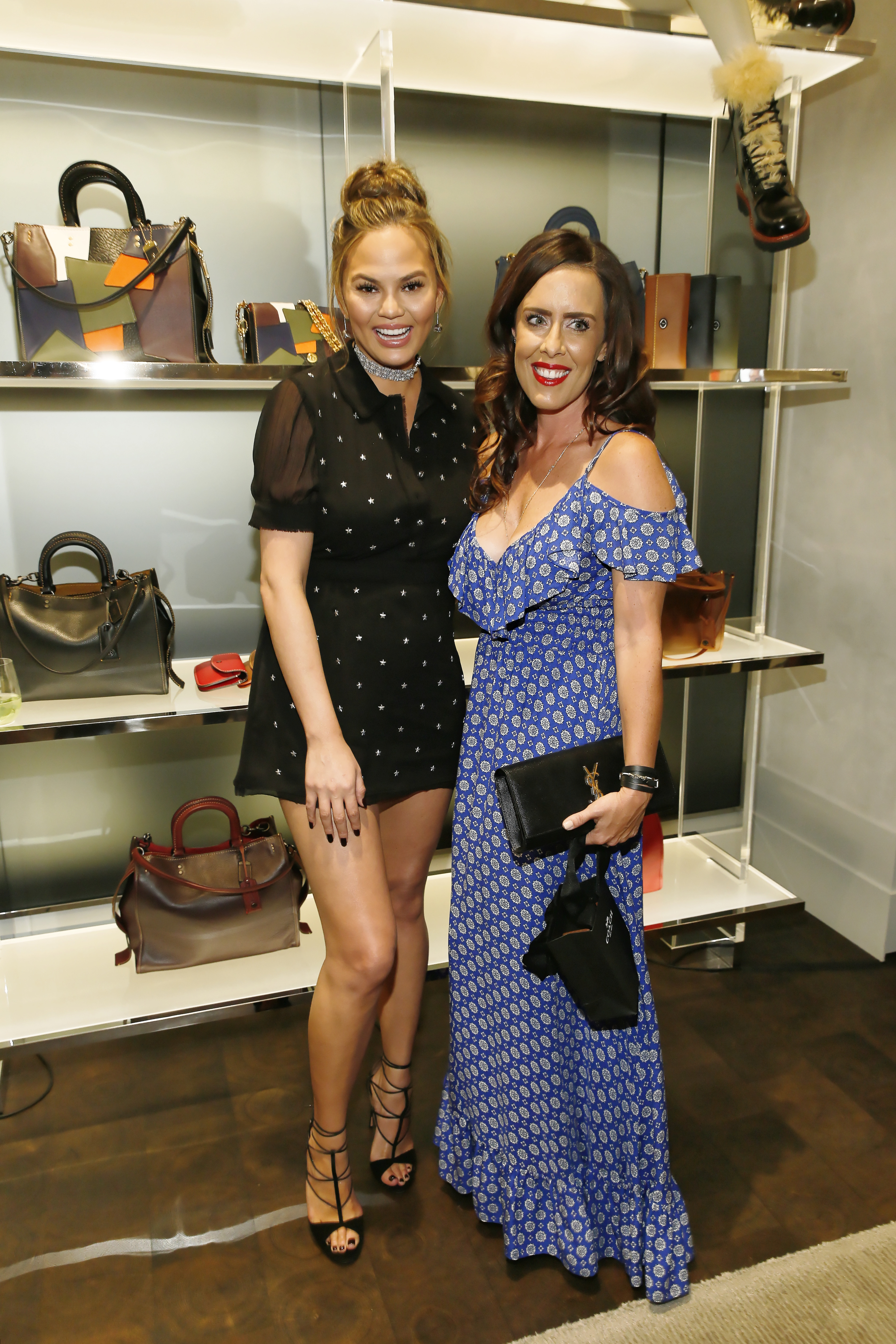 Chrissy Teigen (L) and Cassydy Gavin (R) pose at COACH's Pre-Fall 2016 Collection at the Coach South Coast Plaza boutique on June 16, 2016 in Costa Mesa, California. (Photo by Ryan Miller/Getty Images for COACH)