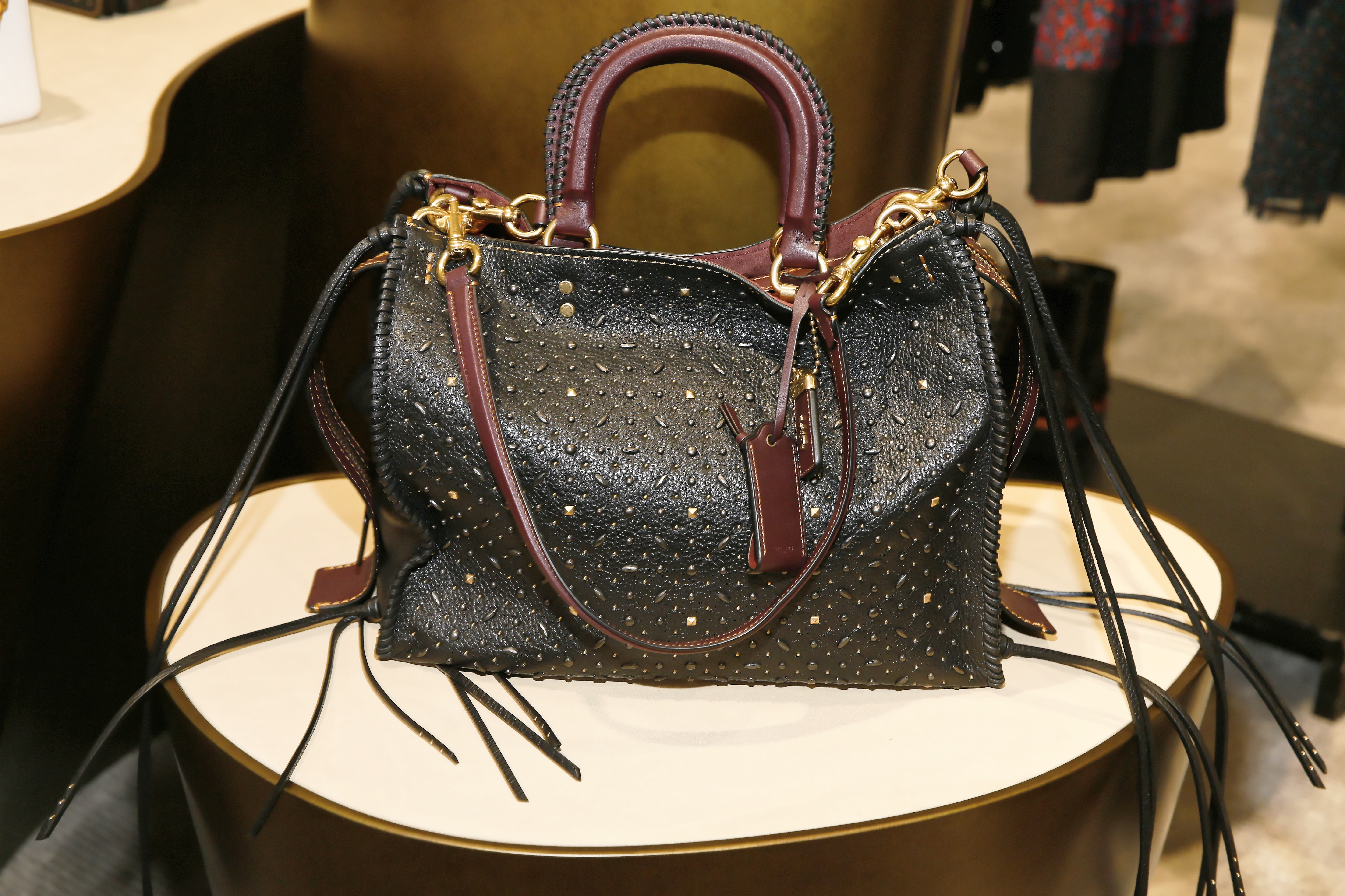 """""""Whiplash"""" rivets rogue bag pebble leather $1,200 from Coach's 1941 Pre Fall 2016 collection at the Coach South Coast Plaza boutique. (Photo by Ryan Miller/Getty Images for COACH)"""