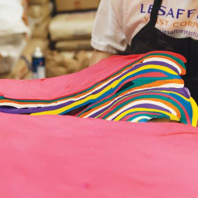 Eight colors of gel-dyed dough are stacked 32 layers high.