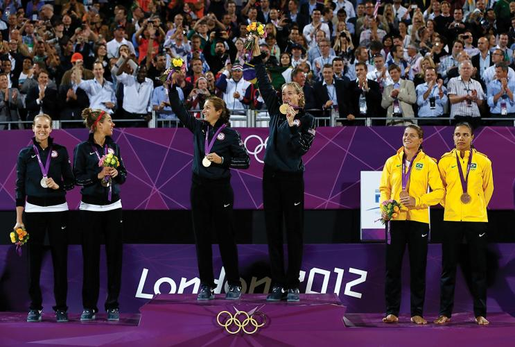 LONDON, ENGLAND - AUGUST 08: (L-R) Silver medallists Jennifer Kessy and April Ross of the United States, Gold medallists Misty May-Treanor and Kerri Walsh Jennings, and Bronze medallists Larissa Franca and Juliana Silva of Brazil celebrate on the podium during the medal ceremony for the Women's Beach Volleyball on Day 12 of the London 2012 Olympic Games at the Horse Guard's Parade on August 8, 2012 in London, England. (Photo by Jamie Squire/Getty Images)