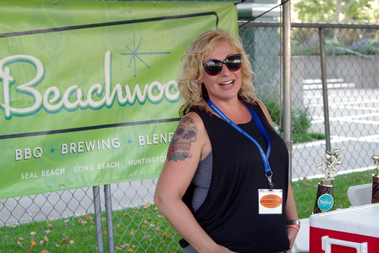 Fauna Shrago, executive director of the O.C. Brewer's Guild, poured for her husband's brewery, Beachwood Brewing
