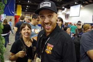 TAPS Corona's brewer Jonathan Chiusano with Bootlegger's Tina on the GABF floor - photo - Nagel
