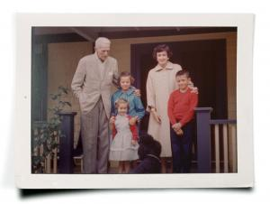 Rivett, in red sweater, meeting her famous grandfather in the spring of 1960, with her sister Ann, brother Evan, and mother Jo Hammett Marshall.
