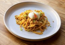 Pancit with uni, sizzled garlic, egg, and fried chicken skin