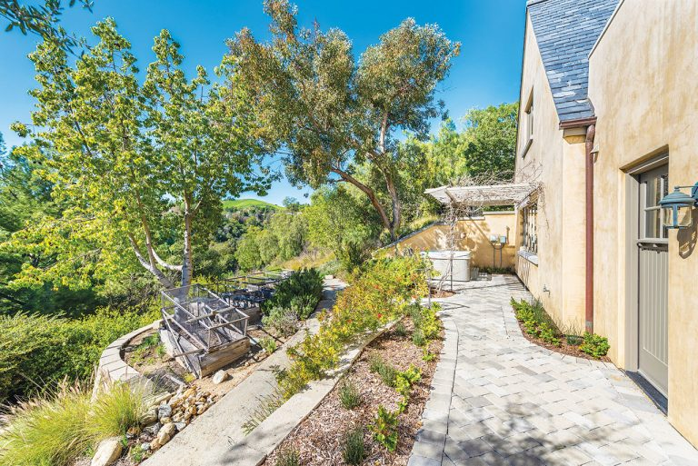 On the Market: This San Juan Capistrano Property Has a Pathway Lined with Garden Spaces