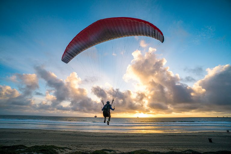 A Paraglider Takes Flight From the Bluffs at Huntington Beach